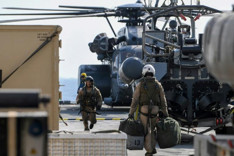 US Black Hawk helicopter crew members took part in the International Maritime Exercise (IMX), led by the US in Gulf waters off Bahrain for three weeks starting October 21 (AFP Photo/KARIM SAHIB)