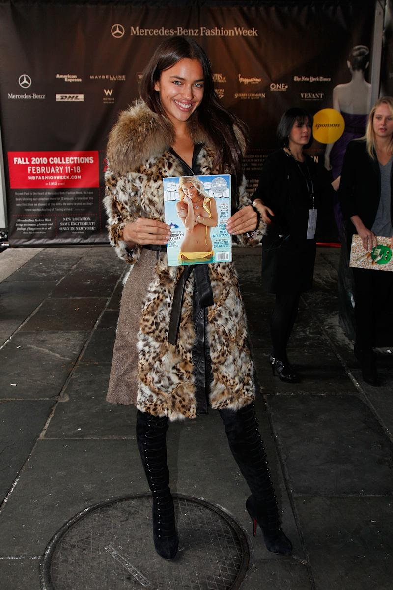Bundled up in an animal-print coat, Shayk shows off the Sports Illustrated swimsuit edition.