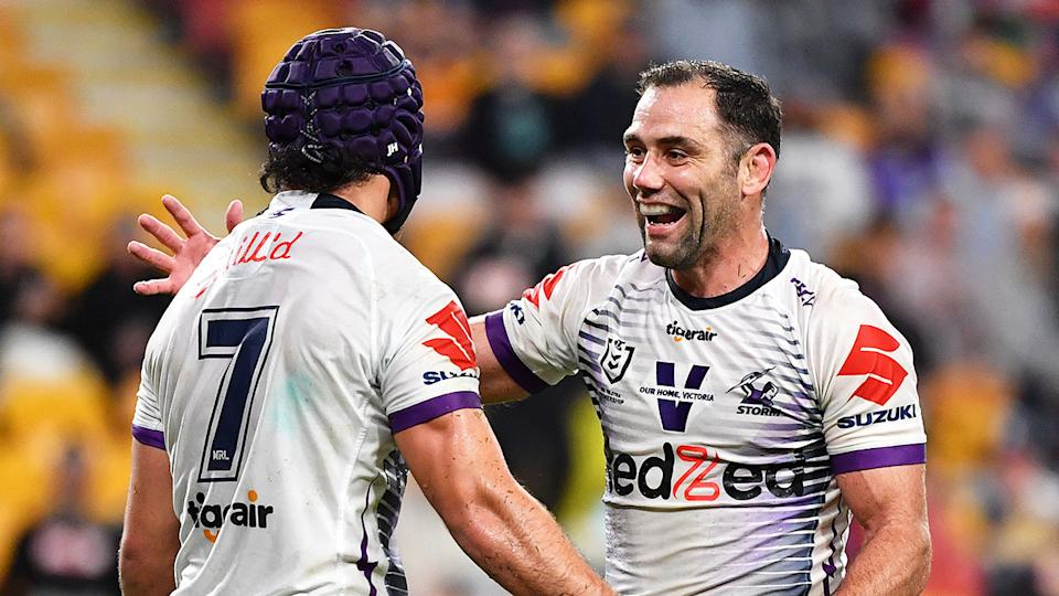 Pictured here, Melbourne Storm legend Cameron Smith celebrates with Jahrome Hughes.