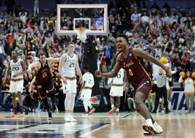 Loyola-Chicago guard Donte Ingram (0) celebrates sinking a three-point basket in the closing seconds of the second half of a first-round game against Miami at the NCAA college basketball tournament in Dallas, Thursday, March 15, 2018. (AP Photo/Tony Gutierrez)