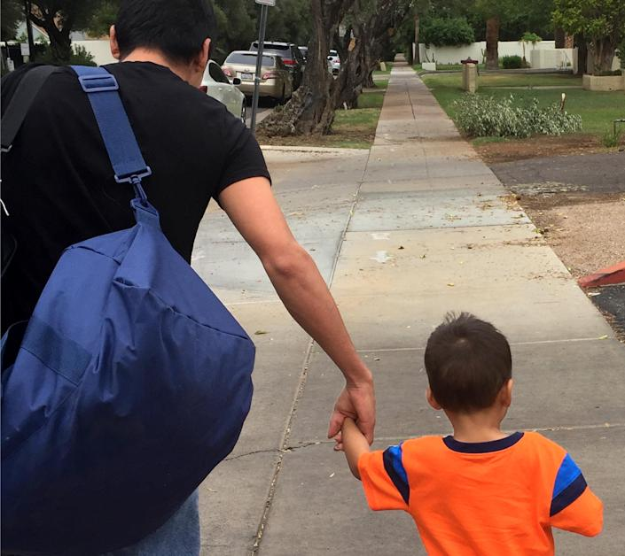 Jose A. and his 3-year-old son were reunited after being separated by border officials at the Hidalgo Port of Entry in Texas in May. (Photo: Gracie Willis/Southern Poverty Law Center)