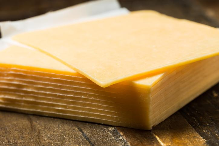 Pictured is sliced cheddar cheese.