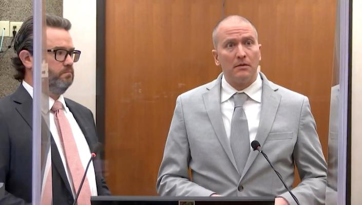 In this image taken from video, former Minneapolis police Officer Derek Chauvin, right, accompanied by defense attorney Eric Nelson, addresses the court as Hennepin County Judge PeterCahill presides over Chauvin's sentencing, Friday, June 25, 2021, at the Hennepin County Courthouse in Minneapolis (AP)