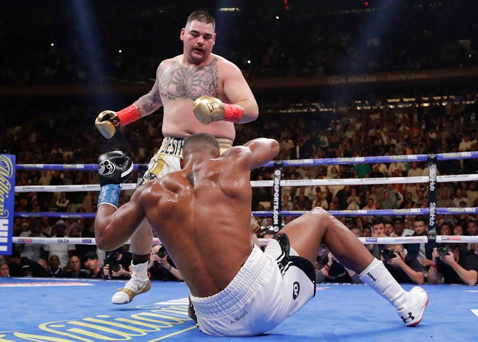 Andy Ruiz knocks down Anthony Joshua during the third round of a heavyweight title boxing match Saturday, June 1, 2019, in New York. Ruiz won in the seventh round. (AP Photo/Frank Franklin II)