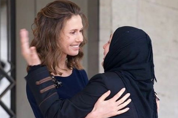 Instagram: Many of the images show Mrs Assad with Syrian families (Instagram)