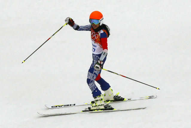 Vanessa Mae, competing for Thailand under her father's name Vanessa Vanakorn, reacts after the second run of the women's alpine skiing giant slalom event at the 2014 Sochi Winter Olympics at the Rosa Khutor Alpine Center February 18, 2014. REUTERS/Ruben Sprich (RUSSIA - Tags: SPORT SKIING OLYMPICS ENTERTAINMENT)