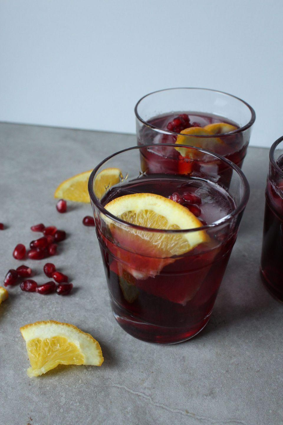 """<p>On the the lookout for a quick and classic punch for your Halloween gathering? Look no further than this simple red wine punch that will add an elegant touch to your bash.</p><p><strong>Get the recipe at <a href=""""http://eatdrinkfrolic.com/2019/01/easy-red-wine-punch.html"""" rel=""""nofollow noopener"""" target=""""_blank"""" data-ylk=""""slk:Eat Drink Frolic"""" class=""""link rapid-noclick-resp"""">Eat Drink Frolic</a>. </strong></p><p><a class=""""link rapid-noclick-resp"""" href=""""https://www.amazon.com/Ball-Mason-Jar-32-Clear-Mouth-Set/dp/B077LWMXFJ/ref=sr_1_8?dchild=1&keywords=mason+jars&qid=1624561124&sr=8-8&tag=syn-yahoo-20&ascsubtag=%5Bartid%7C2164.g.36792938%5Bsrc%7Cyahoo-us"""" rel=""""nofollow noopener"""" target=""""_blank"""" data-ylk=""""slk:SHOP MASON JARS"""">SHOP MASON JARS</a></p>"""