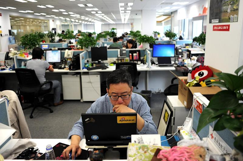 A man uses a laptop at an office of Sina Weibo, China's equivalent to Twitter, in Beijing on April 16, 2014 (AFP Photo/Wang Zhao)