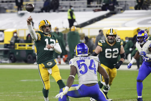 Green Bay Packers quarterback Aaron Rodgers (12) passes during the second half of an NFL divisional playoff football game against the Los Angeles Rams Saturday, Jan. 16, 2021, in Green Bay, Wis. (AP Photo/Mike Roemer)