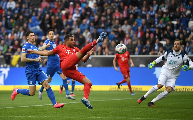Serge Gnabry scores the opener during Bayern Munich's four-goal first half vs. Hoffenheim. (Photo by Matthias Hangst/Bongarts/Getty Images)