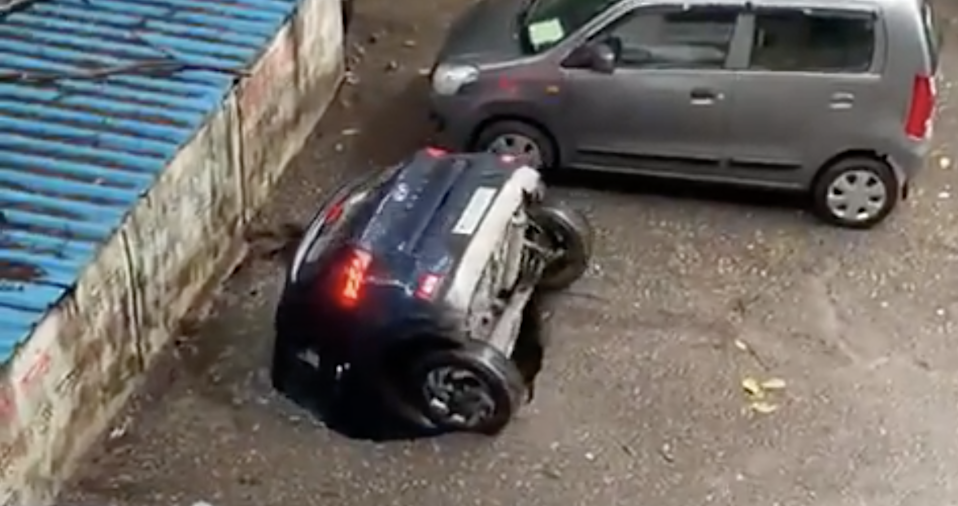 Screengrab from a video of a car falling into a well in a residential complex in Mumbai, India (Twitter)