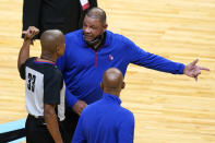 Philadelphia 76ers coach Doc Rivers, right, talks with official Sean Corbin (33) during the first half of the team's NBA basketball game against the Miami Heat, Thursday, May 13, 2021, in Miami. (AP Photo/Lynne Sladky)