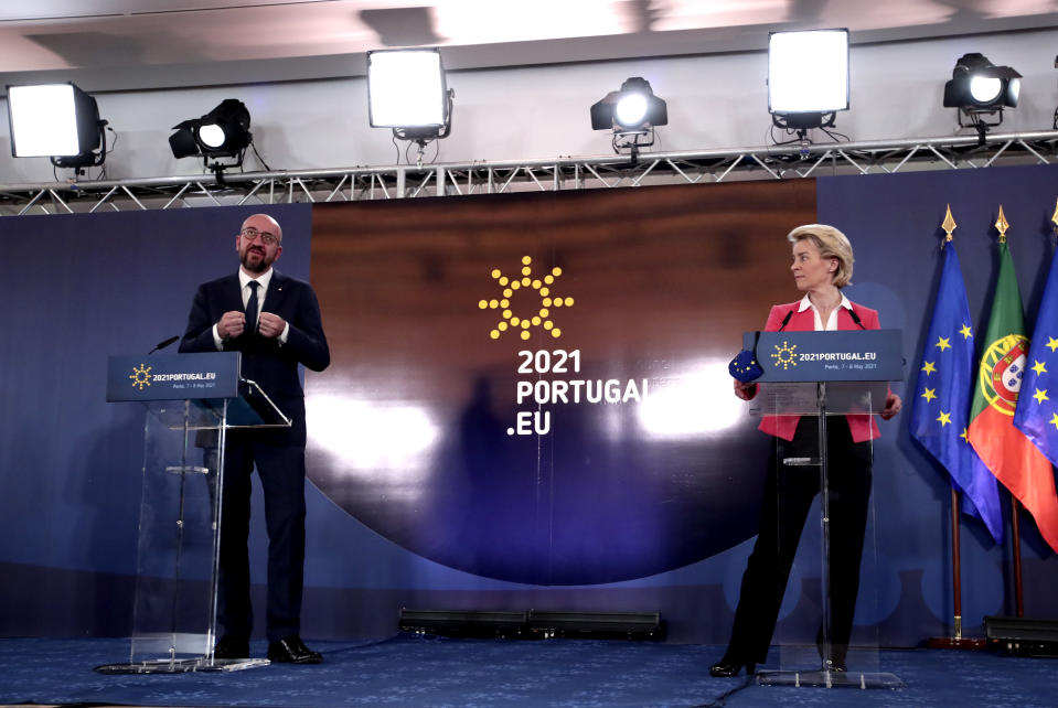 European Commission President Ursula von der Leyen, right, and European Council President Charles Michel address a media conference at an EU summit in Porto, Portugal, Saturday, May 8, 2021. On Saturday, EU leaders held an online summit with India's Prime Minister Narendra Modi, covering trade, climate change and help with India's COVID-19 surge. (AP Photo/Luis Vieira)