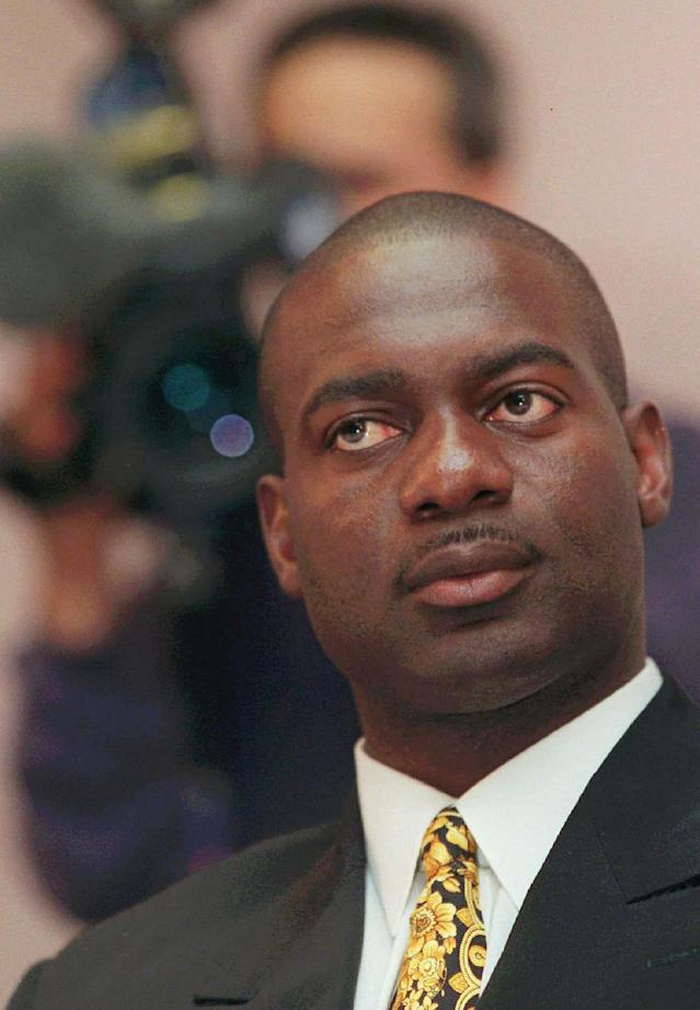 (CPT107)TORONTO, May 13--JOHNSON--Canadian sprinter Ben Johnson listens at a news conference in Toronto Tueday. Johnson and his lawyers filed an appilication in Ontario court in an attempt to have his lifetime ban from competing in international track overturned. (CP PHOTO)1997 (str-Kevin Frayer)