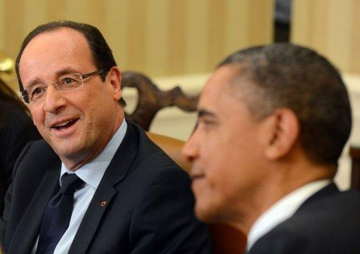 US President Barack Obama (R) listens as French President Francois Hollande speaks following their bilateral meeting