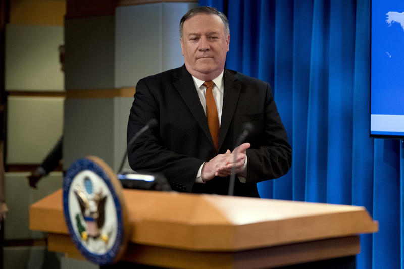 Secretary of State Mike Pompeo arrives to speak at a news conference in the press briefing room at the State Department in Washington, Friday, Sept. 14, 2018, in Washington. Pompeo says his Obama-era predecessor John Kerry has been 'actively undermining' U.S. policy on Iran. (AP Photo/Andrew Harnik)