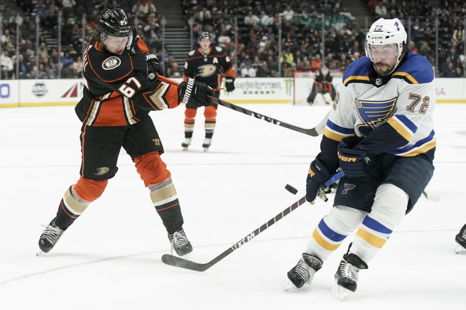 St. Louis Blues defenseman Justin Faulk, right, blocks a shot by Anaheim Ducks left wing Rickard Rakell during the second period of an NHL hockey game in Anaheim, Calif., Wednesday, March 11, 2020. (AP Photo/Chris Carlson)