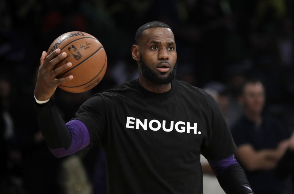 Los Angeles Lakers' LeBron James wears a T-shirt for the 12 victims of Wednesday night's shooting at a bar in Thousand Oaks, Calif., before an NBA basketball game against the Atlanta Hawks Sunday, Nov. 11, 2018, in Los Angeles. (AP Photo/Marcio Jose Sanchez)