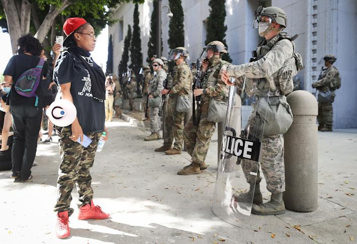 A protester looks at National Guard troops posted in Los Angeles on June 3. Jackson was among their ranks. (Photo: Mario Tama via Getty Images)