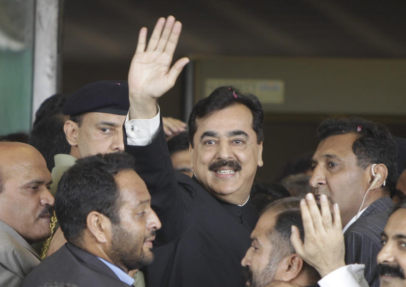 FILE - In this Thursday, April 26, 2012 file photo, Pakistani Prime Minister Yousuf Raza Gilani waves upon his arrival at the Supreme Court for a hearing in Islamabad, Pakistan.  Pakistan's top court declared on Tuesday, June 19, 2012 that the country's prime minister was disqualified from office due to an earlier contempt conviction, delivering what appeared to be fatal blow against the premier's political career and ushering in political turmoil. (AP Photo/B.K. Bangash, File)