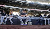 Colorado Rockies shortstop Troy Tulowitzki relaxes o[n a chair while awaiting batting practice and other pre game activities at the MLB National League baseball game against the San Diego Padres Tuesday, April 15, 2014, in San Diego. (AP Photo/Lenny Ignelzi)