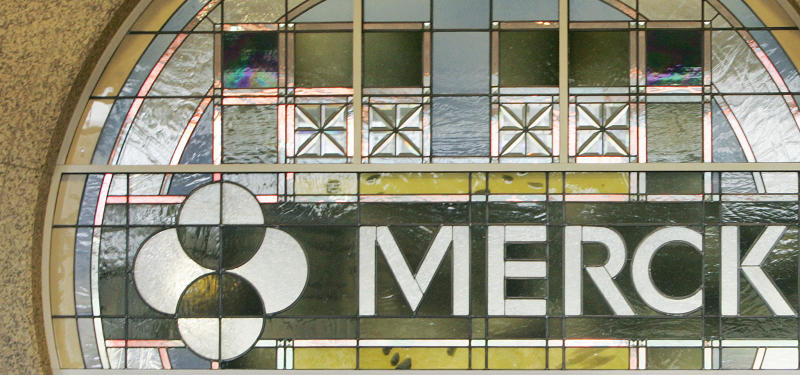 FILE - In this file photo made April 15, 2009, the Merck logo is seen in the lobby of Merck & Company, Inc.'s world headquarters in Whitehouse Station, N.J. Federal health officials said Monday, April 25, 2011, a highly-anticipated drug to treat hepatitis C made by Merck appears to cure more patients in less time than established drugs that have been used for 20 years.  (AP Photo/Mel Evans, File)