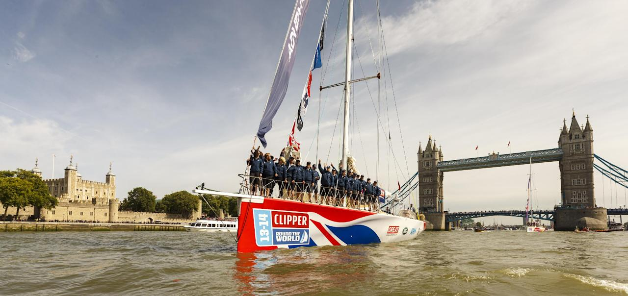 The Great Britain Clipper, leads four of the twelve Clipper Round the World Race yachts through Tower Bridge past the Tower of London during the start of the Clipper Round the World Race at St Katharine Docks, London.