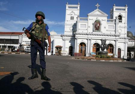 A security officer stands in front of St Anthony's shrine in Colombo, after bomb blasts ripped through churches and luxury hotels on Easter, in Sri Lanka April 22, 2019. REUTERS/Athit Perawongmetha