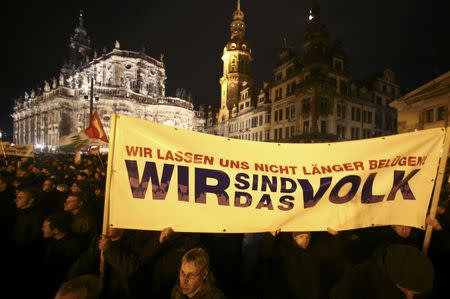 """File photo of participants holding a banner during a demonstration called by anti-immigration group PEGIDA, a German abbreviation for """"Patriotic Europeans against the Islamization of the West"""", in Dresden December 22, 2014. REUTERS/Hannibal Hanschke/Files"""