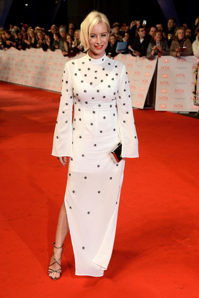 <p>Denise Van Outen donned a sleek flute-sleeved dress with a knee-high split for the awards night. <em>[Photo: Getty]</em> </p>