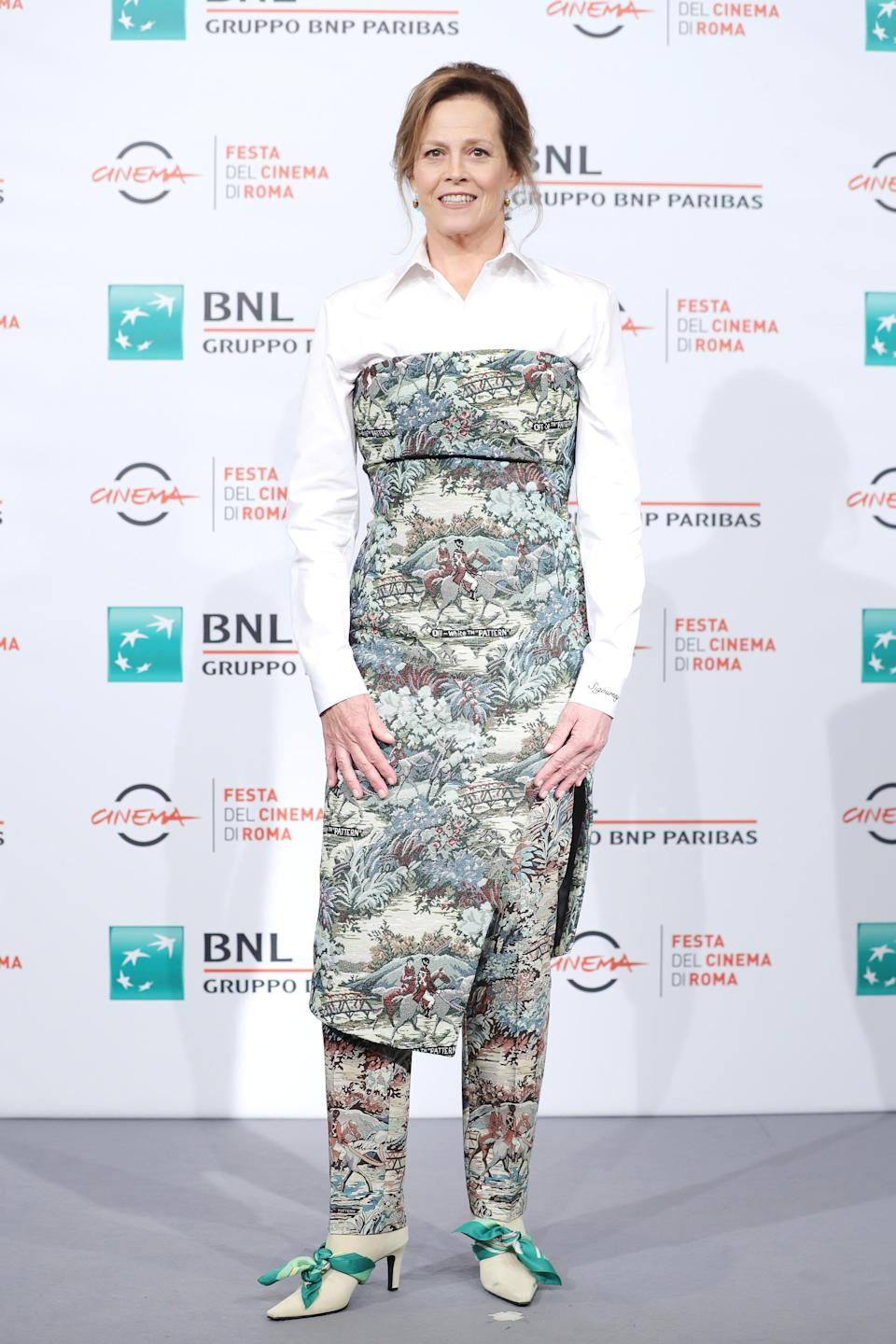 <p>The actress graced the headlines during Rome Film Festival courtesy of a tapestry-effect cold-shoulder dress and co-ordinating trousers. One of the most popular brands of the year Off-White was behind the ensemble and you either love it or you hate it. Either way, it was certainly a talking point. <em>[Photo: Getty]</em> </p>