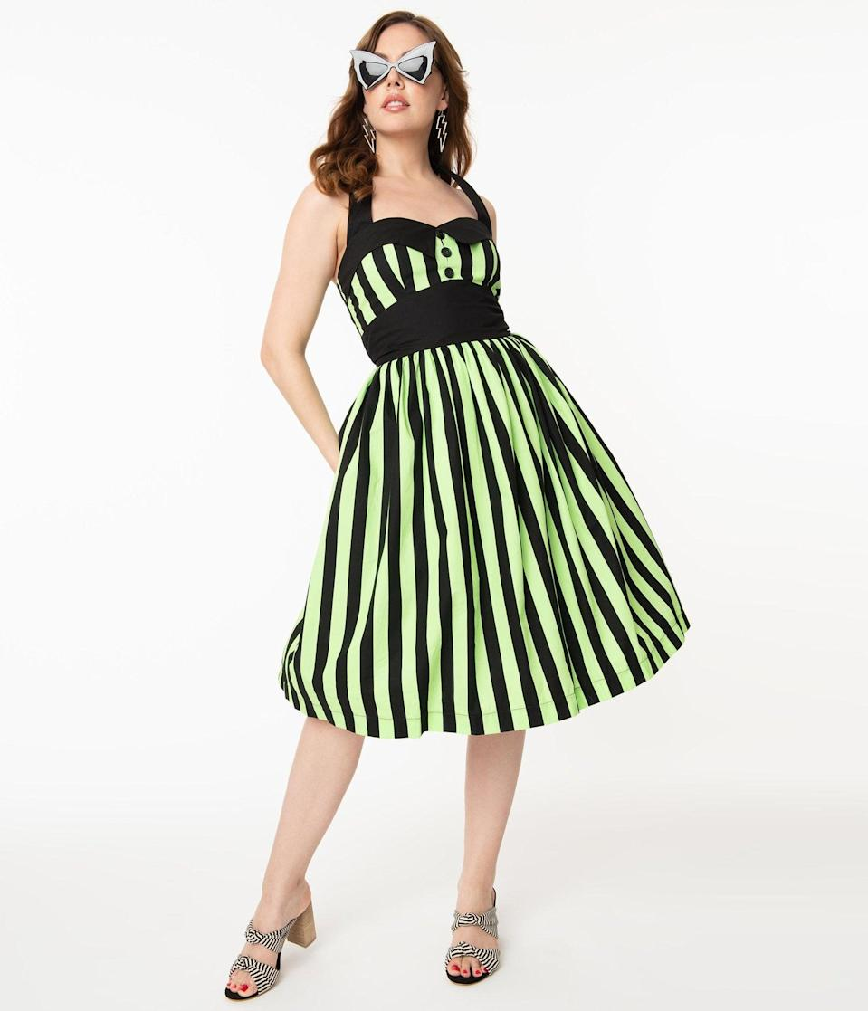 <p>We're getting major <strong>Beetle Juice</strong> vibes from this <span>1950s Style Neon Green and Black Stripe Ashley Swing Dress</span> ($88).</p>