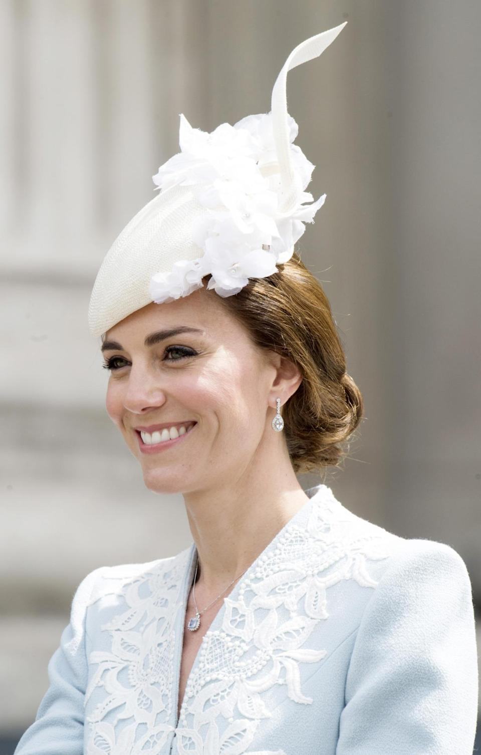 <p>The duchess paired the pretty coat with a white fascinator from Jane Taylor<i>. <i>(Photo: Rex Features)</i></i></p>