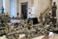 WASHINGTON, DC - JANUARY 13: Members of the National Guard rest in the Visitor Center of the U.S. Capitol on January 13, 2021 in Washington, DC. Security has been increased throughout Washington following the breach of the U.S. Capitol last Wednesday, and leading up to the Presidential inauguration. (Photo by Stefani Reynolds/Getty Images)