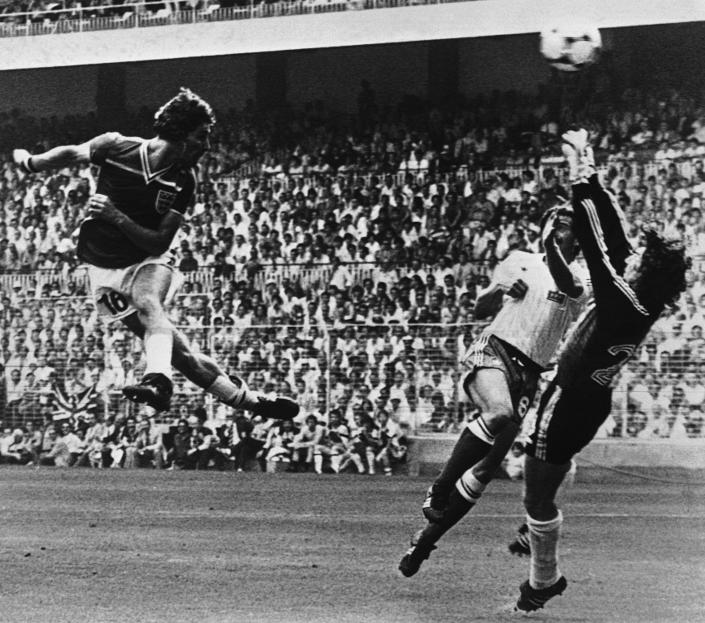 FILE - In this June 16, 1982 file photo England's Bryan Robson, left, heads the ball past French goalkeeper Jean Ettori, right, and defender Christian Lopez, to score his and England's second goal during the World Cup soccer match between England and France in Sam Manes Stadium, Bilbao. England defeated France 3-1. (AP Photo, File)