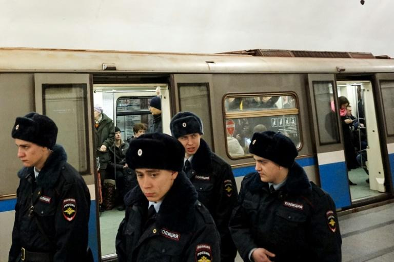 Russian police officers patrol at Prospekt Mira metro station on April 4, 2017 in Moscow, as security measures are tightened following the blast in the Saint Petersburg metro