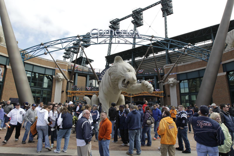 FILE - This April 5, 2012 file photo shows fans outside Comerica Park before a baseball game between the Detroit Tigers and Boston Red Sox, in Detroit. Comerica Park is the latest Detroit landmark to be the subject of a bomb threat. Police say an anonymous caller issued the threat in a 911 call around 8 p.m. Tuesday, July 17, 2012, as the Tigers were hosting the Los Angeles Angels in front of 34,000 fans. (AP Photo/Carlos Osorio, File)