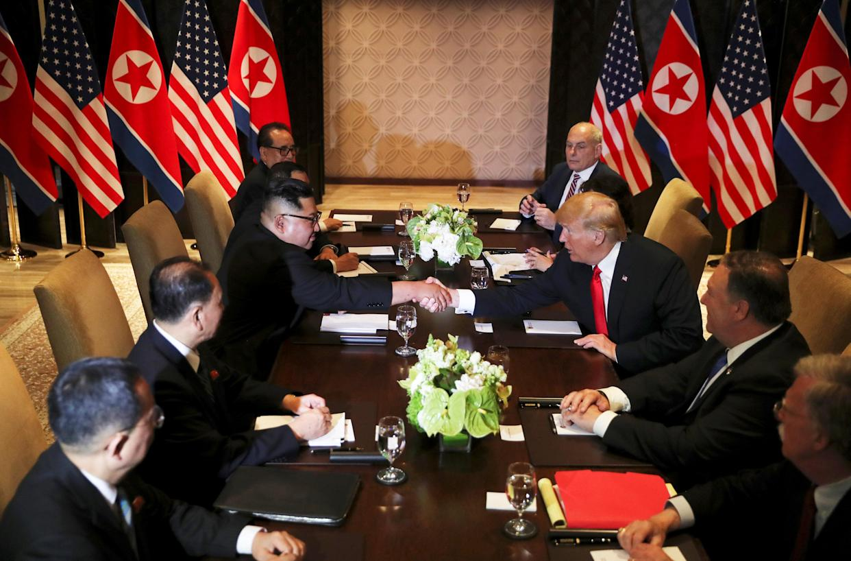 President Trump with Kim Jong Un at their expanded bilateral meeting in Singapore on Tuesday. (Photo: Jonathan Ernst/Reuters)