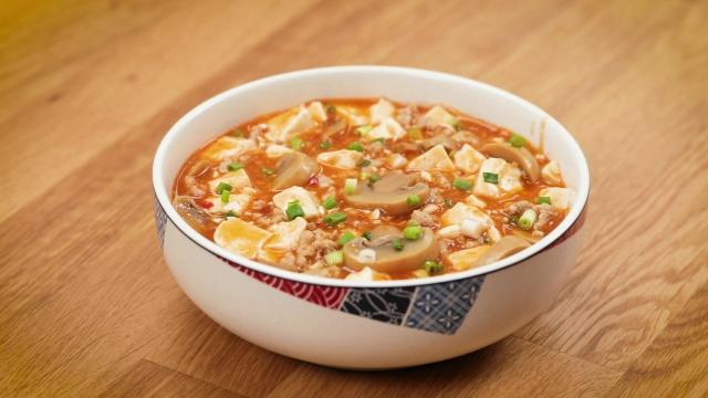 mapo tofu with canned mushrooms in a white bowl