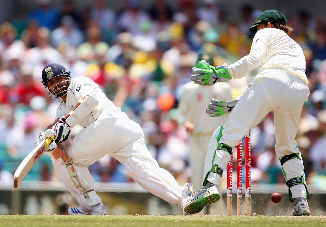 SYDNEY, AUSTRALIA - JANUARY 04:  Sachin Tendulkar of India sweeps during day three of the Second Test match between Australia and India at the Sydney Cricket Ground on January 4, 2008 in Sydney, Australia. The Benaud statue is the first of ten to be unveiled in the SCG Trust sports sculpture project.  (Photo by Cameron Spencer/Getty Images)