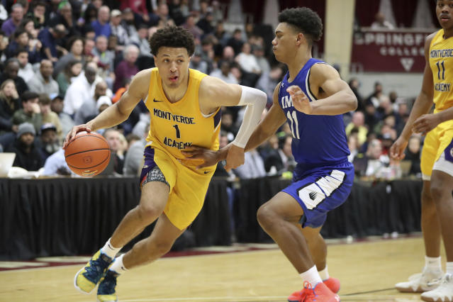 FILE - In this Jan. 19, 2020, file photo, Montverde Academy's Cade Cunningham (1) drives against an unidentified IMG Academy defender during a high school basketball game at the Hoophall Classic in Springfield, Mass. Cunningham, one of the nation's top recruits, has chosen to remain at Oklahoma State despite the program being banned from the 2021 postseason. Many wondered what Cunningham, a one-and-done prospect, would do. He made his announcement in a video he posted to social media on Monday, June 22, 2020. (AP Photo/Gregory Payan, File)