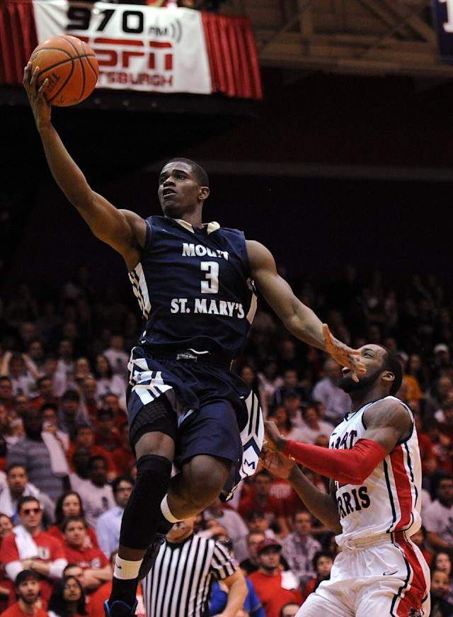 Mount St. Mary's' Sam Prescott (3) drives for a lay up against Robert Morris' Lucky Jones during the first half of the Northeastern Conference championship NCAA college basketball game on Tuesday, March 11, 2014, in Coraopolis, Pa. (AP Photo/Don Wright)