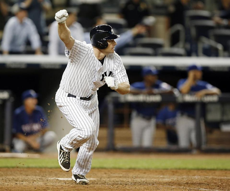 New York Yankees Chase Headley celebrates after hitting a 14th-inning walk-off RBI single in the Yankees 2-1 victory over the Texas Rangers in a baseball game at Yankee Stadium in New York, Wednesday, July 23, 2014. (AP Photo)