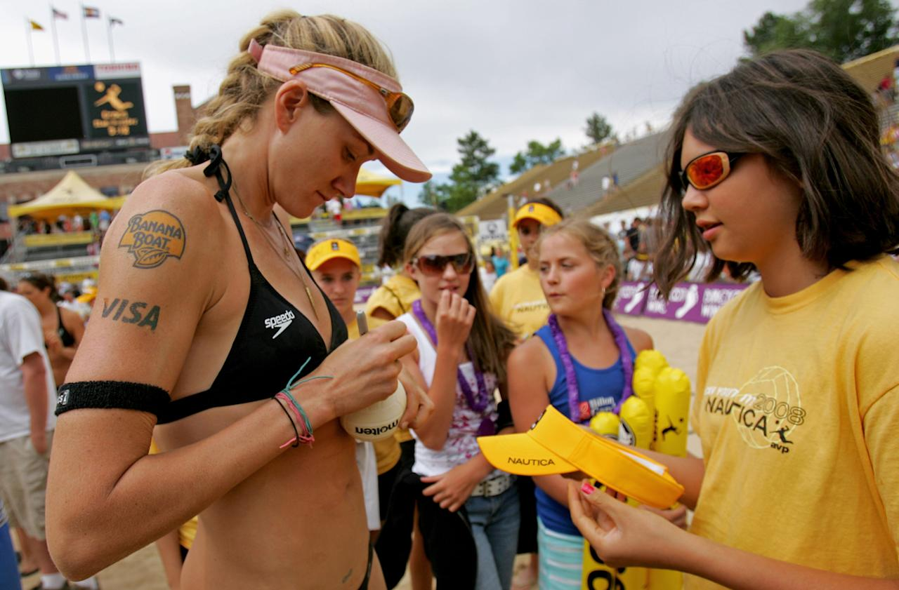 Kerri Walsh signs an autograph for a fan after she and Misty May-Treanor defeated Annett Davis and Jenny Johnson Jordan in the Women's Final of the 2008 AVP Crocs Slam Boulder Open at Folsom Field on July 6, 2008 in Boulder, Colorado.