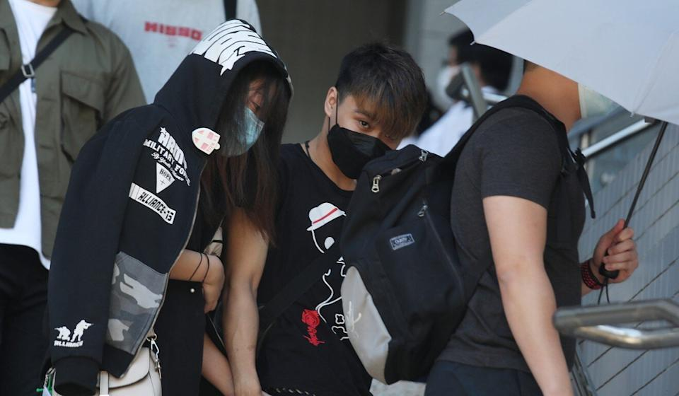 Lin Chun-hung (centre) appears at Kowloon City Court accused of rioting, among other charges. Photo: Xiaomei Chen