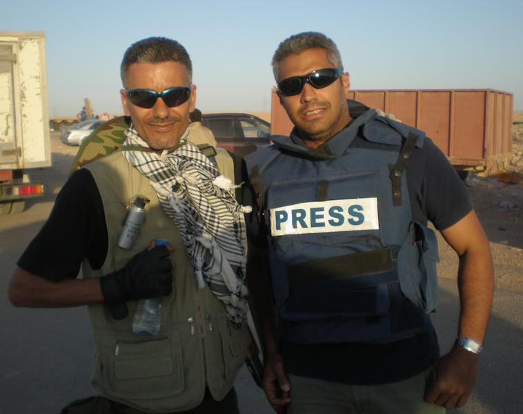 In this undated photo provided by the family of Fahmy, Mohamed Fahmy, a journalist for the Qatar-based Al-Jazeera English channel, right, poses for a photo with his friend journalist at an unknown location in Libya. Egypt's interim President Adly Mansour told the Fahmy family of the jailed Egyptian-Canadian journalist tried on terrorism-related charges that he has instructed authorities to provide him with necessary medical attention, in a letter received Sunday, March 23, 2014. (AP Photo/Family of Fahmy)