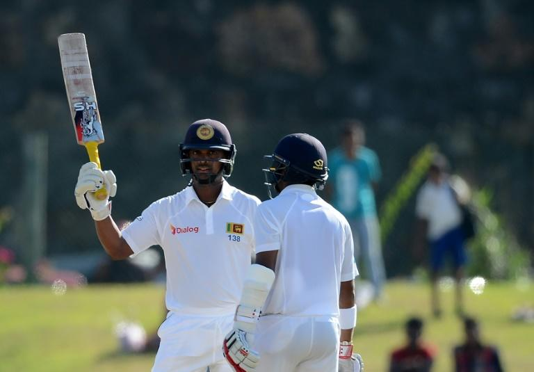 Sri Lanka's Asela Gunaratne (left) celebrates reaching his half-century on the first day of the opening Test against Bangladesh in Galle on March 7, 2017