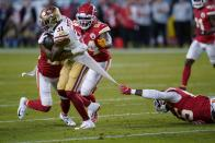 Kansas City Chiefs defensive end Frank Clark, right, tries to tackle San Francisco 49ers running back Raheem Mostert, left, during the first half of the NFL Super Bowl 54 football game Sunday, Feb. 2, 2020, in Miami Gardens, Fla. (AP Photo/David J. Phillip)