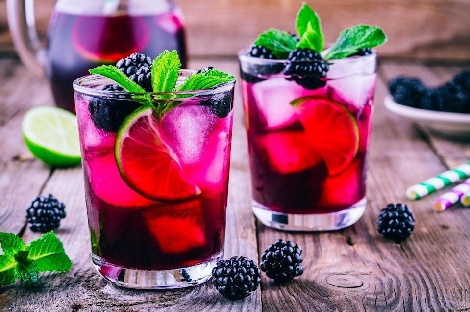 """<p>Add 40 blackberries to a jug and muddle together. Mix in x1 part orange juice to three parts <a href=""""https://www.amazon.co.uk/Shloer-Grape-Sparkling-Juice-Drink/dp/B005LM0KSO/ref=sr_1_1_0g_fs?almBrandId=QW1hem9uIEZyZXNo&dchild=1&fpw=alm&keywords=Shloer+Red+Grape.&qid=1605893439&s=grocery&sr=1-1"""" rel=""""nofollow noopener"""" target=""""_blank"""" data-ylk=""""slk:Shloer Red Grape."""" class=""""link rapid-noclick-resp"""">Shloer Red Grape.</a> Top up with soda water, stir and serve over ice, before garnishing with more blackberries and sprigs of mint. </p>"""