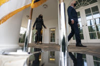 President Joe Biden, right, followed by Vice President Kamala Harris, walks out of the Oval Office to speak about the American Rescue Plan, a coronavirus relief package, in the Rose Garden of the White House, Friday, March 12, 2021, in Washington. (AP Photo/Alex Brandon)